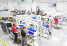 KAMA manufacturing students work on a manufacturing line at the RMTC campus in Battle Creek.