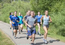 KCC cross-country runners run around Spring Lake.