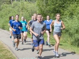 KCC cross-country runners run around Spring Lake.