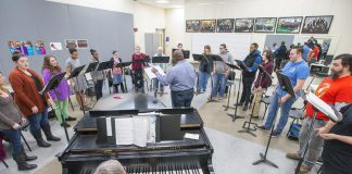 KCC choir members rehearse in the choir room.