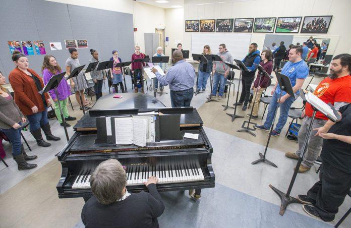 KCC choir members rehearse in the choir room.