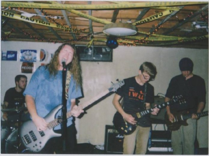 Local indie rock band Super Tan playing music.