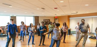 Hustle Dance Class in the Kellogg Room. Participants learning to dance.