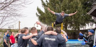 KCC Police Academy cadets cheer on a fellow student as he jumps during the polar plunge event in 2017.