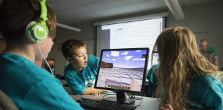 Kids playing computer game Minecraft.