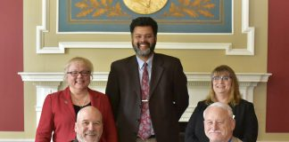 KCC's Vice President and President sitting with deans and instructors from Olivet College