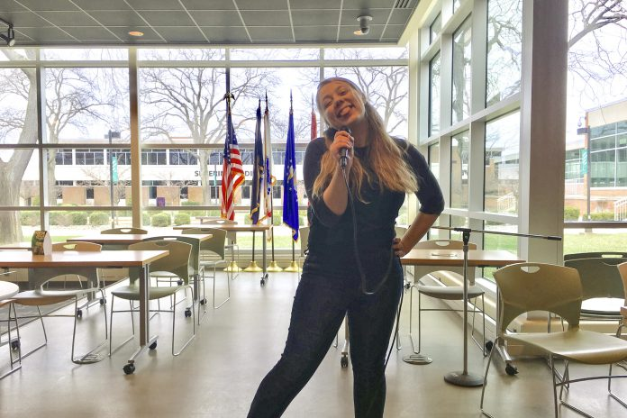 Drea singing karaoke in the Student Center at KCC