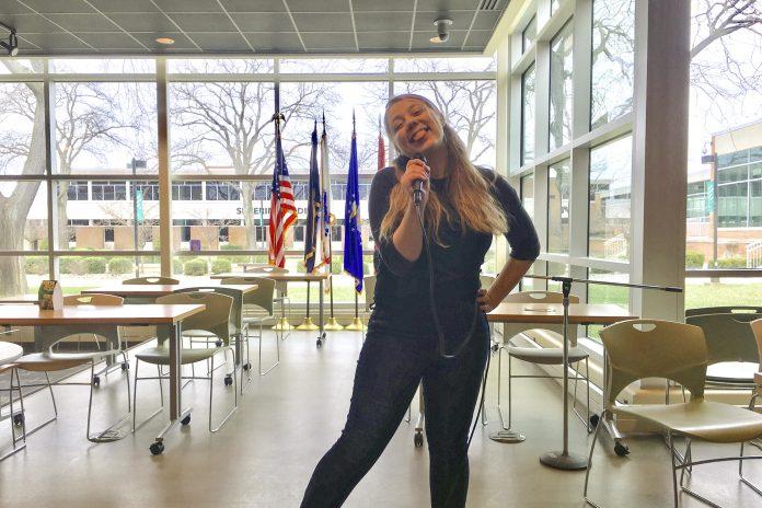Drea singing karaoke in the Student Center at KCC
