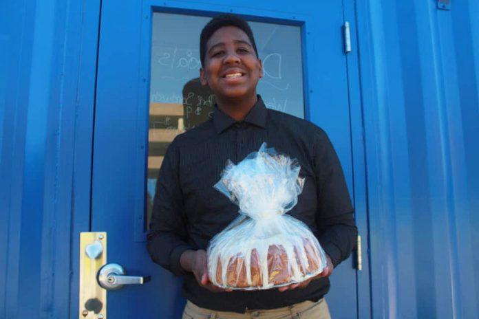 Jordan Edwards holding a baked good.