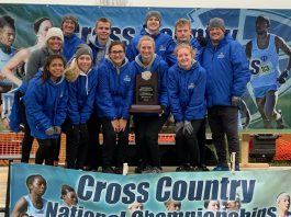 Photo of KCC Cross Country team in Iowa