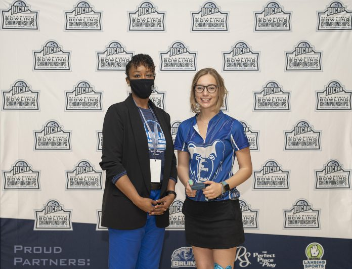Kellogg Community College bowler Kelsey Kipp poses with KCC President Dr. Adrien Bennings with an award following the NJCAA Championship in Lansing. Photo courtesy of KCC.
